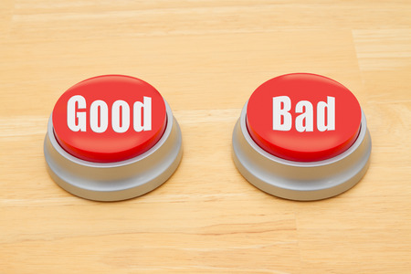 Two red and silver push button on a wooden desk with text Good and Bad Reklamní fotografie