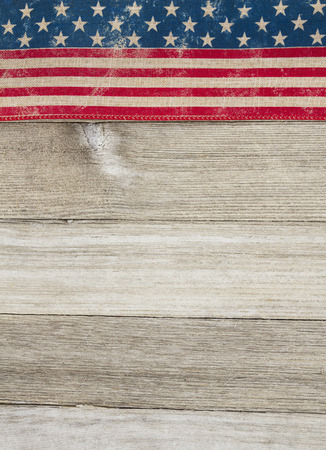 space wood: USA patriotic old flag on a weathered wood background with copy space for message