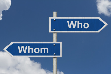 grammatical: Blue road sign with words Who and Whom with sky background