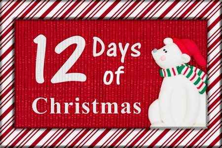 12 days of christmas: Red shiny fabric with a candy cane border and a Santa polar bear with text 12 Days of Christmas Stock Photo