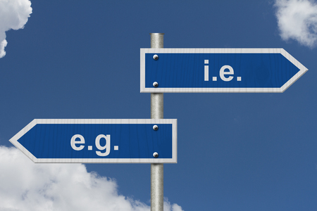 ie: Learning to use proper grammar, Blue road sign with words i.e e.g. with sky background Stock Photo