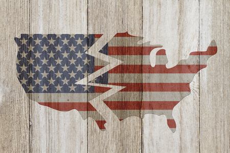divided: Divided USA patriotic old flag on a map with weathered wood background with copy space for message
