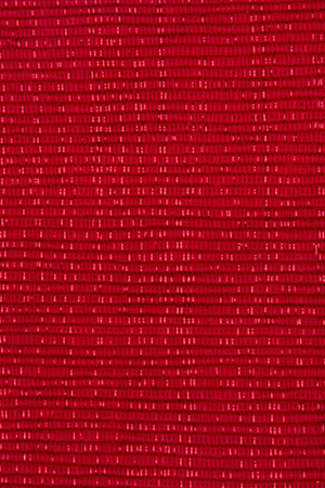 copyspace: Sparkly red fabric background with copy-space for your message