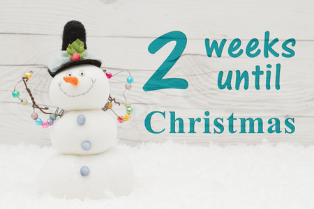 christmas countdown message some snow and a snowman on weathered wood with text 2 weeks - Weeks Until Christmas