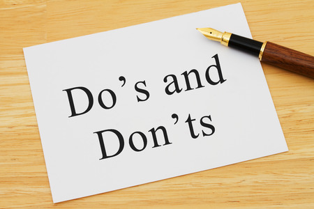 grammatical: Learning to use proper grammar, A white card on a desk with a pen with words Dos and Donts