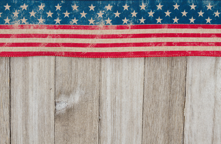 space wood: USA patriotic old flag on a weathered wood background with copy space for your message Stock Photo