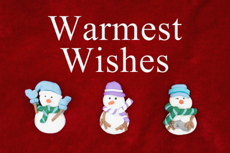 warmest: Warmest Wishes greeting, Red plush fabric with three snowmen background with text Warmest Wishes Stock Photo