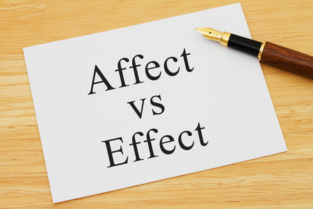 grammatical: Learning to use proper grammar, A white card on a desk with a pen with words Affect vs Effect