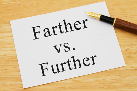 grammatical: Learning to use proper grammar, A white card on a desk with a pen with words Farther vs Further