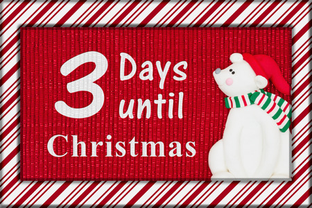 Christmas countdown message, Red shiny fabric with a candy cane border and a Santa polar bear with text 3 days until Christmas