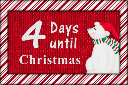 Christmas countdown message, Red shiny fabric with a candy cane border and a Santa polar bear with text 4 days until Christmas Banco de Imagens