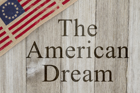 american dream: America patriotic message, USA patriotic old flag on a weathered wood background with text The American Dream