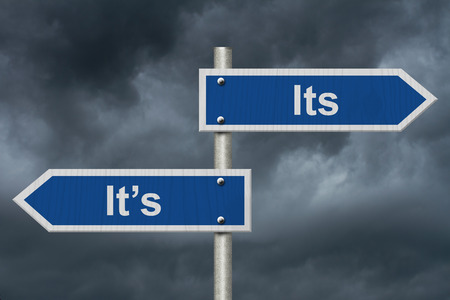 grammatical: Learning to use proper grammar, Blue road sign with words Its Its with stormy sky background Stock Photo