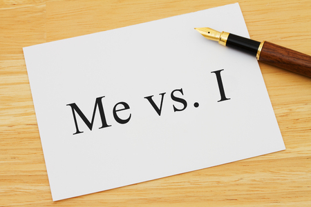 grammatical: Learning to use proper grammar, A white card on a desk with a pen with words Me vs I