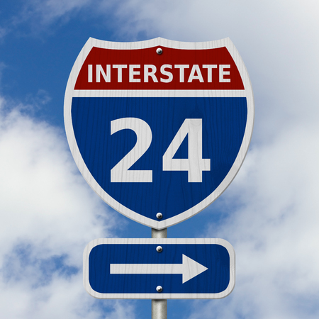 USA Interstate 24 highway sign, Red, white and blue interstate highway road sign with number 24 with sky background  Stock Photo