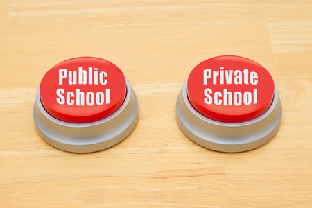 private schools: The difference between public school and private school, Two red and silver push button on a wooden desk with text Public School and Private School Stock Photo