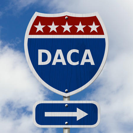 DACA USA Interstate highway sign, Red, white and blue interstate highway road sign with text DACA with sky background