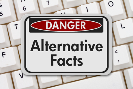 disinformation: Alternative Facts danger sign, A black and white danger sign with text Alternative Facts on a keyboard