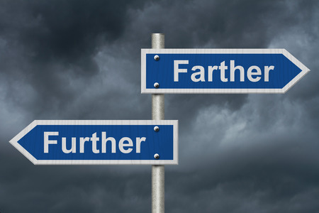 grammatical: Learning to use proper grammar, Blue road sign with words Farther and Further with stormy sky background