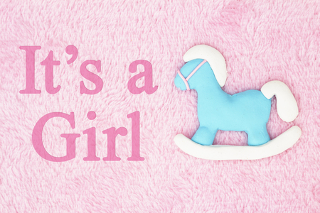 Old fashion Its a girl message, A hobby horse with pink fabric background and text Its a Girl