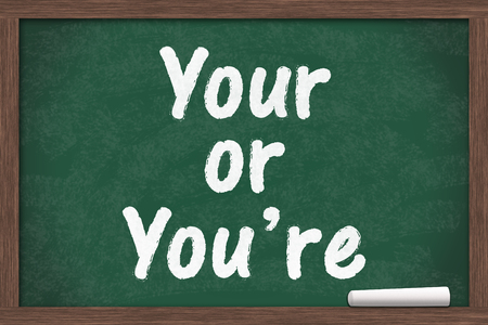 grammatical: Learning to use proper grammar, Chalkboard with a piece of chalk and text Your or Youre