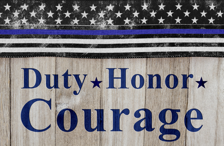 hallowed: Duty Honor and Courage message, USA thin blue line flag on a weathered wood background with text Duty Honor  Courage Stock Photo