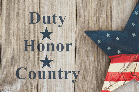 hallowed: Duty Honor and Country message, USA patriotic old flag on a star a weathered wood background with text Duty Honor Country