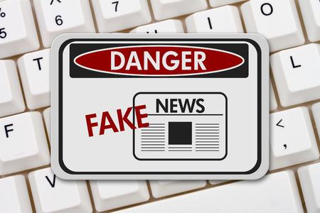 computers online: Fake News danger sign, A black and white danger sign with text Fake News on a keyboard