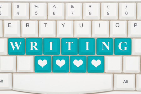 Love writing on the internet, A close-up of a keyboard with teal highlighted text Writing and hearts