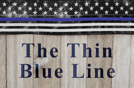 hallowed: The thin blue line message, USA thin blue line flag on a weathered wood background with text The Thin Blue Line