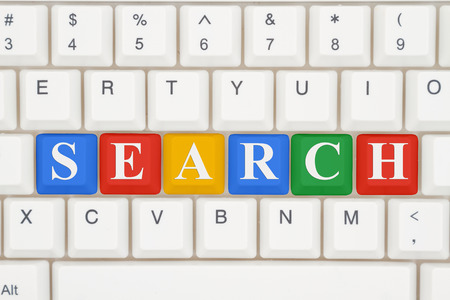 search searching: Searching for information on the Internet, A close-up of a keyboard with multicolored highlighted text Search