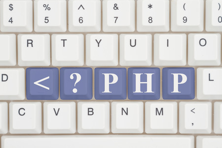 Computer coding with php, A close-up of a keyboard with purple highlighted text