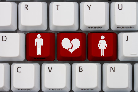 Dating on the internet gone wrong, A close-up of a keyboard with red highlighted text with woman and man symbol and broken heart 스톡 콘텐츠