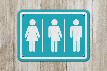 All inclusive transgender sign, Teal and white sign with a woman, a transgender and man symbol on weathered wood Imagens