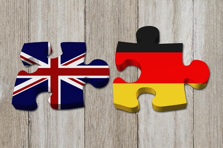 Relationship between the Britain and Germany, Two puzzle pieces with the flags of Britain and Germany on weathered wood