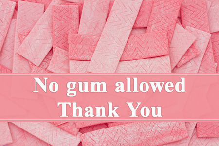 A lot of pink chewing gum sticks with text No gum allowed Thank You