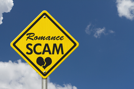 Romance Scam yellow warning road sign, Yellow caution sign with words Romance Scam with sky background