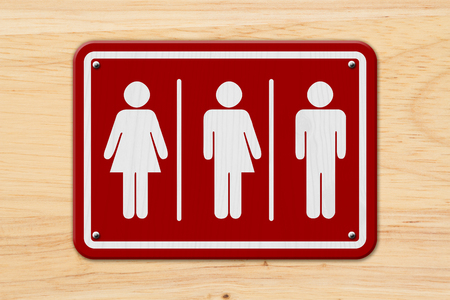 All inclusive transgender sign, Red and white sign with a woman, a transgender and man symbol on wood Standard-Bild
