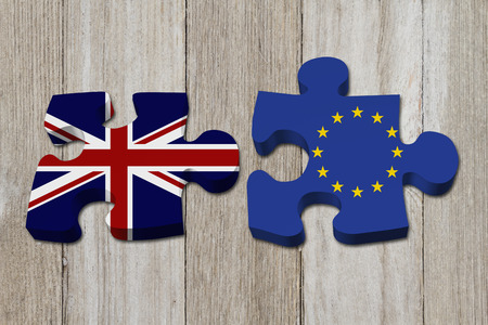Relationship between the Britain and EU, Two puzzle pieces with the flags of Britain and EU on weathered wood