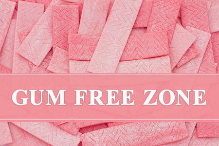 A lot of pink chewing gum sticks with text Gum Free Zone