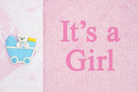 Old fashion Its a girl message, A baby carriage with pink fabric background and text Its a Girl