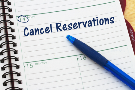 Reminder to cancel your reservations, A day planner with blue pen with text Cancel Reservations Фото со стока - 77815085