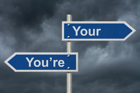 grammatical: Learning to use proper grammar, Blue road sign with words Your Youre with stormy sky background