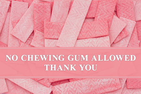 A lot of pink chewing gum sticks with text No chewing gum allowed Thank You