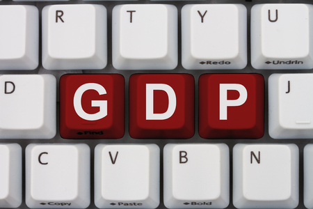 Research GDP on the internet, A close-up of a keyboard with red highlighted text GDP Stock Photo