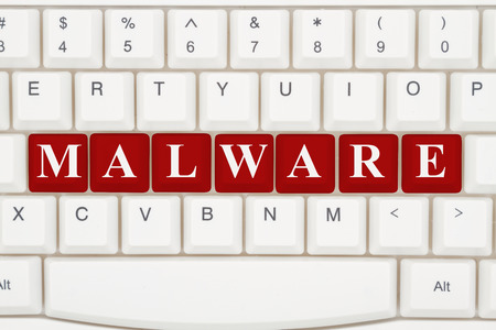 website words: Getting malware on the internet, A close-up of a keyboard with red highlighted text Malware