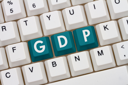 Research GDP on the internet, A close-up of a keyboard with teal highlighted text GDP