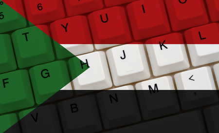 Internet access in Sudan, The Sudanese flag on a computer keyboard Stock Photo