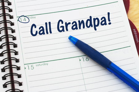 Reminder to call your grandfather, A calendar with a pen and text Call Grandpa
