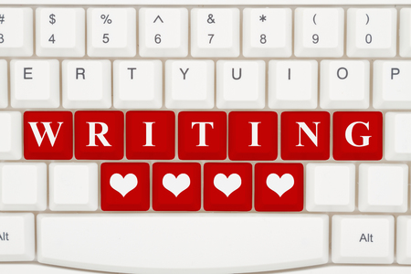 Love writing on the internet, A close-up of a keyboard with red highlighted text Writing and hearts